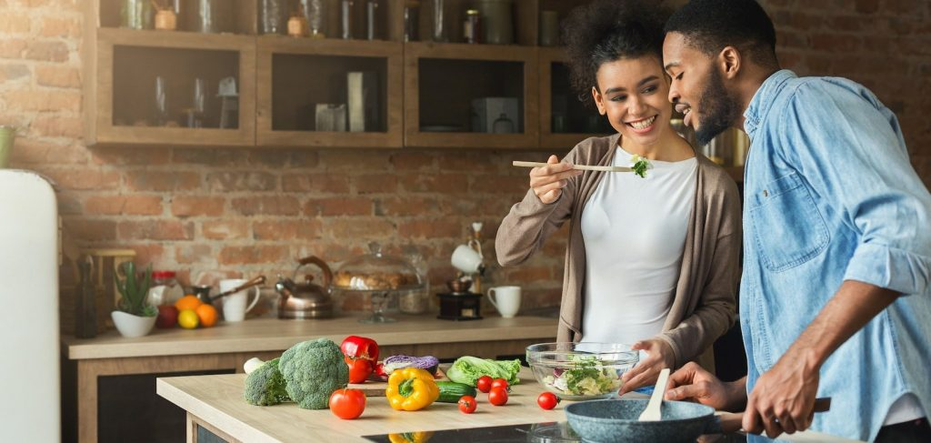 african-american couple preparing a detox meal