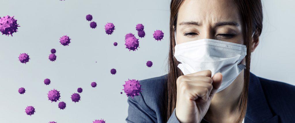 woman sneezing virus